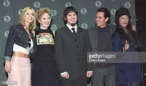 """Grammy nominees Britney Spears , Leigh Nash and Matt Slocum of the group """"Six Pence None the Richer"""", Marc Anthony and La India pose for..."""