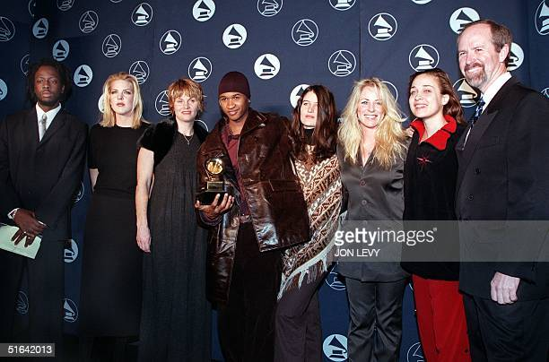 Grammy nominees pose with Mike Greene president and CEO of the National Academy of Recording Arts and Sciences at a press conference to announce the...