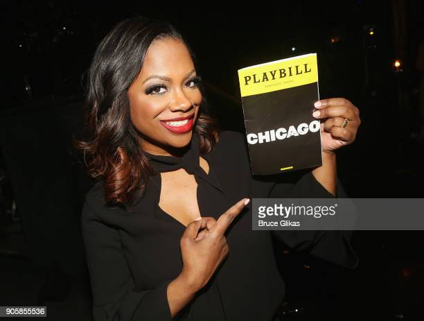 Grammy Winner Kandi Burruss of The Real Housewives of Atlanta poses backstage after making her broadway debut as Mama Morton in the hit musical...