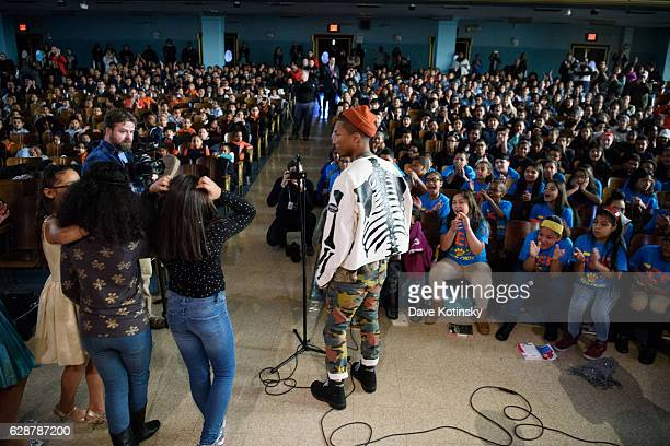 Grammy Winning Artist Pharrell Williams Crashes Middle School Assembly For Surprise Performance With Amp Up NYC Students on December 9 2016 in New...