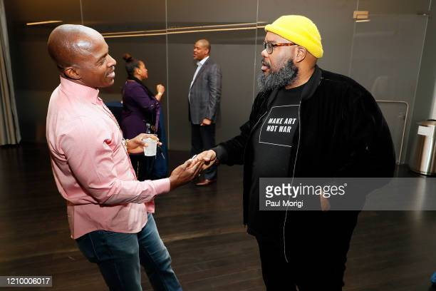 Grammys DC Chapter Board Member Kokayi talks with a guest at The Recording Academy Washington DC Chapter's Intersection of Music Sports event at the...