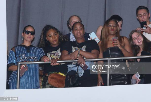 Grammywinning entertainer Alicia Keys and American tennis pro Serena Williams view a stage show from a VIP balcony at the Bacardi No Commission...