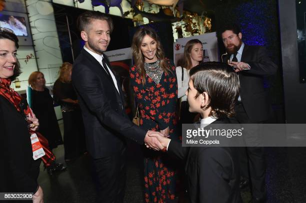 Grammywinning songwriter and producer Ryan Tedder and Genevieve Tedder meet Syrian refugees during the 5th Annual Save the Children Illumination Gala...