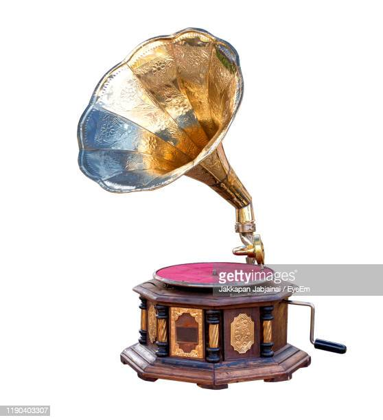 gramophone against white background - gramophone stock pictures, royalty-free photos & images