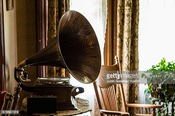 gramophone on table at home - gramophone stock pictures, royalty-free photos & images