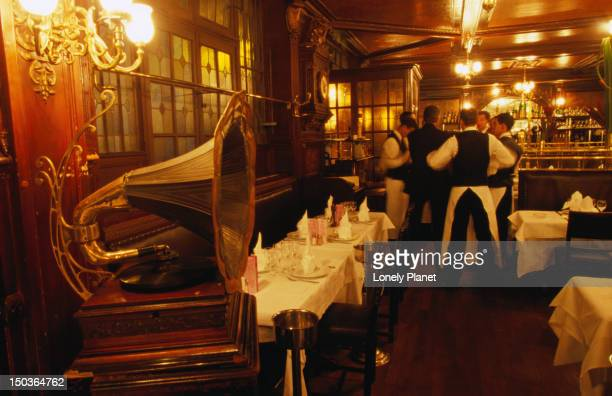 gramophone with waiters behind inside brasserie flo. - brasserie stock pictures, royalty-free photos & images