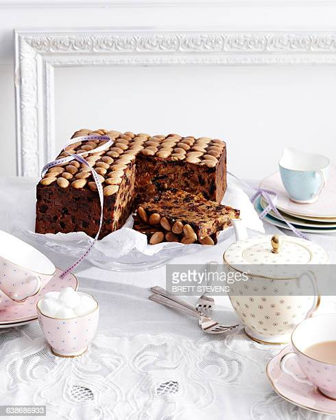 gran marnier fruit cake on traditional tea table - sugar bowl crockery stock photos and pictures