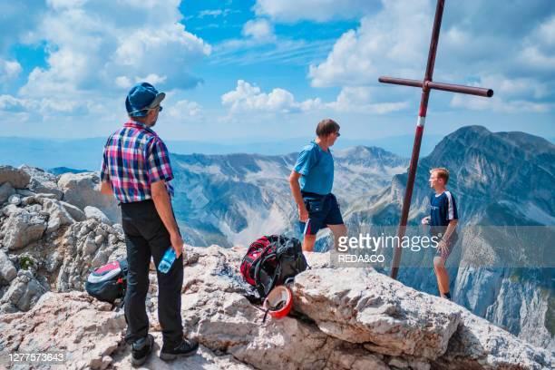 Gran Sasso National Park. Hikers on the summit of the Corno Piccolo. Teramo. Abruzzo. Italy. Europe.