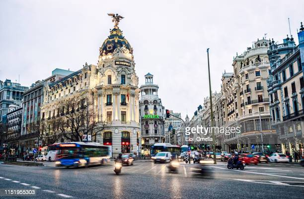 gran via in madrid at sunset with clouds. spain - madrid foto e immagini stock