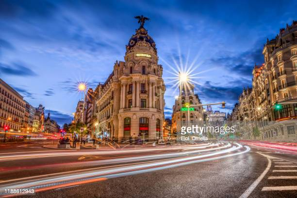 gran via in madrid at sunset with light trails. spain - madrid stock pictures, royalty-free photos & images