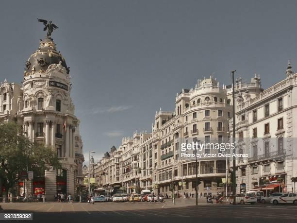 gran via street and alcala street intersection in madrid, spain - victor ovies fotografías e imágenes de stock