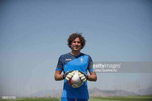 Granada CF football team's new player Mexican goalkeeper Guillermo Ochoa poses on the pitch during his official presentation in Granada on July 26...
