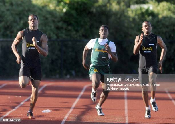 Granada High's George Atkinson III left Livermore High's Shawn Simms center and Granada High's Josh Atkinson right run in the 200 meter during their...