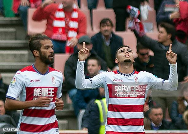 Granada's Belgian midfielder Andreas Pereira celebrates a goal beside Granada's Moroccan midfielder Mehdi Carcela during the Spanish league football...
