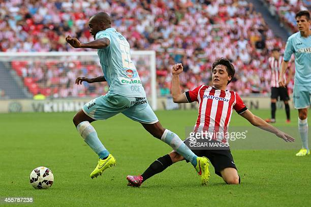 Granada's French defender Dimitri Foulquier vies with Athletic Bilbao's midfielder Unai Lopez during the Spanish league football match Athletic Club...