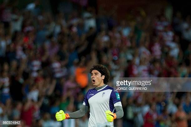 Granada's Mexican goalkeeper Guillermo Ochoa celebrates a goal during the Spanish league football match Granada FC vs Villarreal CF at Nuevo Los...
