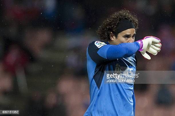 Granada's Mexican goalkeeper Guillermo Ochoa wipes his face during the Spanish league football match Granada CF vs Real Sociedad at Nuevo Los...