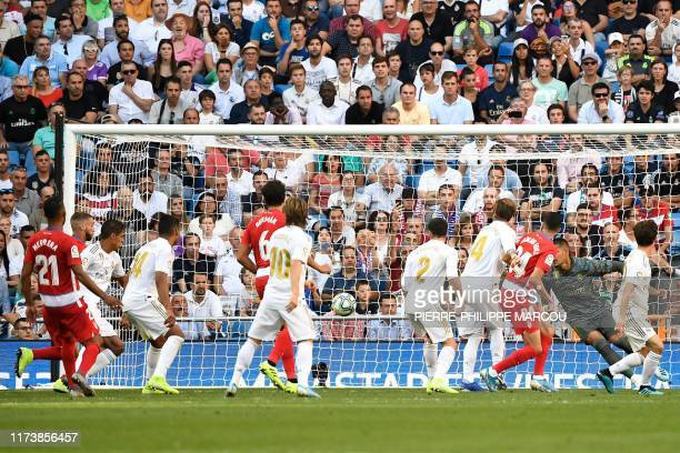 Granada's Portuguese defender Domingos Duarte scores his team's second goal during the Spanish league football match between Real Madrid CF and...