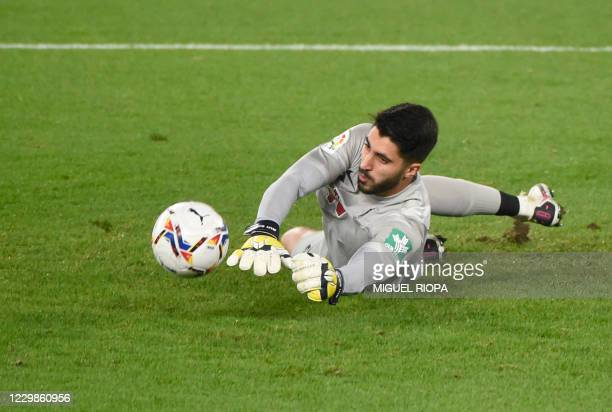 Granada's Portuguese goalkeeper Rui Silva dives to stop a ball during the Spanish League football match between RC Celta de Vigo and Granada FC at...