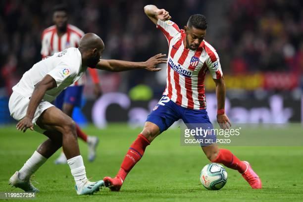 Granada's Spanish defender Bernardo Cruz vies with Atletico Madrid's Brazilian defender Renan Lodi during the Spanish league football match between...