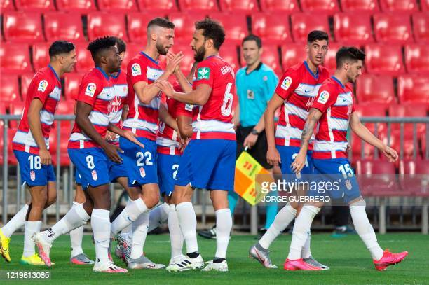Granada's Spanish forward Carlos Fernandez celebrates his goal with teammates during the Spanish League football match between Granada and Getafe at...