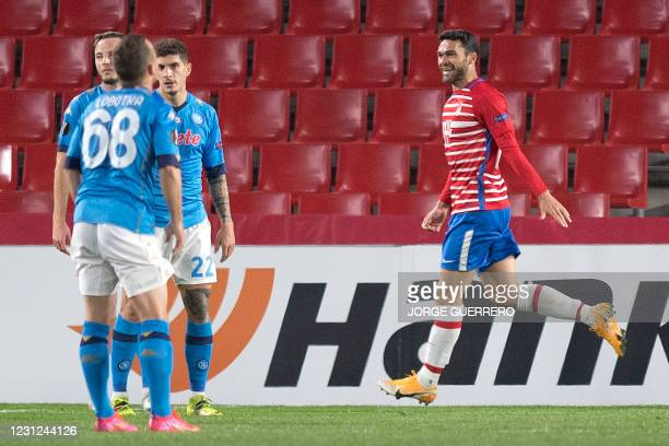 Granada's Spanish forward Jorge Molina celebrates Granada's Brazilian midfielder Robert Kenedy's goal during the UEFA Europa League round of 32 first...