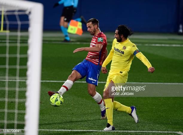 Granada's Spanish forward Roberto Soldado scores a goal during the Spanish league football match Villarreal CF against Granada FC at La Ceramica...