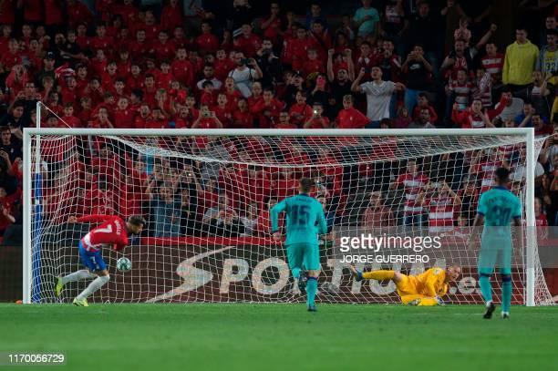 Granada's Spanish midfielder Alvaro Vadillo shoots a penalty kick to score a goal during the Spanish league football match between Granada FC and FC...
