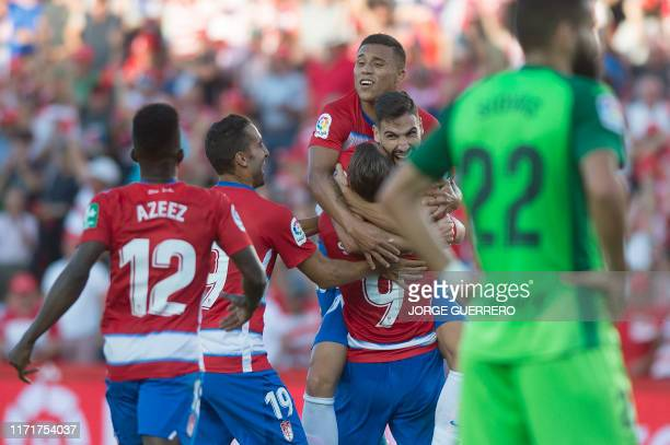 Granada's Spanish midfielder Antonio Puertas celebrates with Spanish forward Roberto Soldado after scoring during the Spanish league football match...
