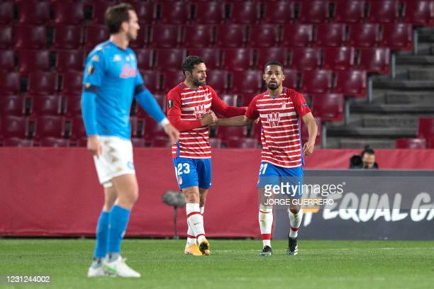 Granada's Venezuelan midfielder Yangel Herrera celebrates his goal with Spanish forward Jorge Molina during the UEFA Europa League round of 32 first...