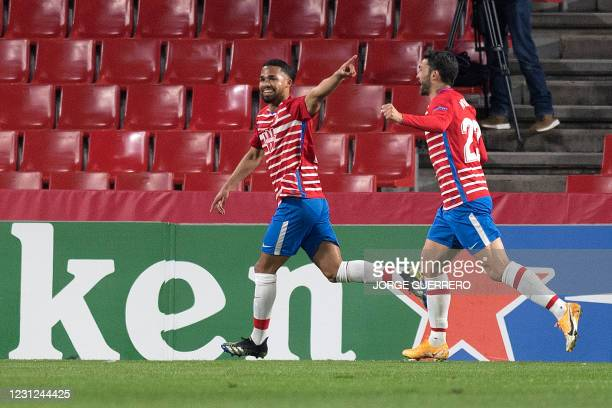 Granada's Venezuelan midfielder Yangel Herrera celebrates his goal during the UEFA Europa League round of 32 first leg football match between Granada...