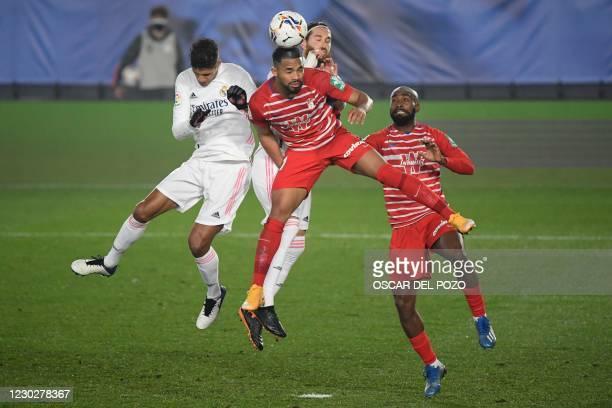 Granada's Venezuelan midfielder Yangel Herrera vies with Real Madrid's French defender Raphael Varane and Real Madrid's Spanish defender Sergio Ramos...