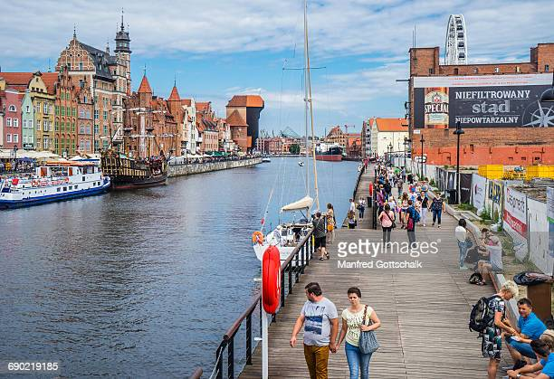 granary island boardwalk gdansk - motlawa river stock pictures, royalty-free photos & images
