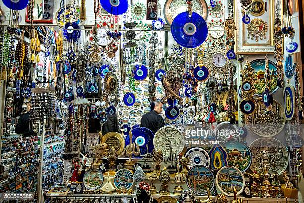 Grand Bazaar in Istanbul is one of the largest and oldest covered markets in the world. This photo show a shop selling Charms used to ward off the...