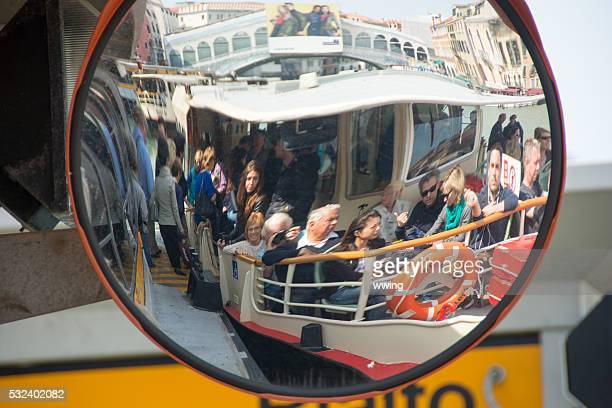 grand canal- a vapoetto with passengers shown in dock mirror - vaporetto stock photos and pictures