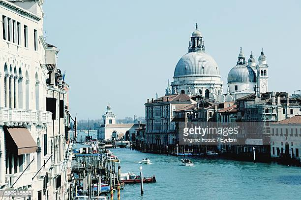 grand canal and punta della dogana against clear sky - punta della dogana stock photos and pictures