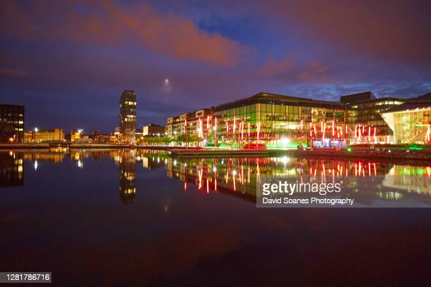 grand canal square at night in dublin, ireland - david soanes stock pictures, royalty-free photos & images