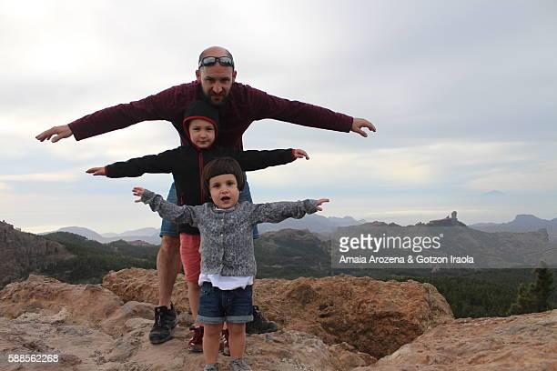 Grand Canary island, Spain. Father and his two small children on the top of Pico de las Nieves mountain