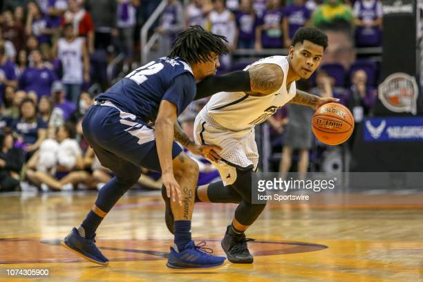 Grand Canyon Lopes guard Damari Milstead dribbles the ball during a college basketball game between the Grand Canyon Lopes and the Nevada Wolf Pack...