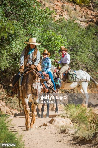 Grand Canyon women mule riders cowgirls Bright Angel Trail Arizona