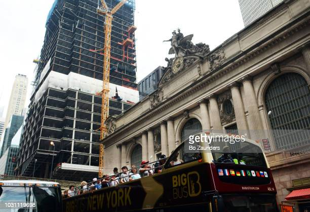 Grand Central Terminal, tour bus, and, under construction, One Vanderbilt, in Midtown Manhattan, NYC.
