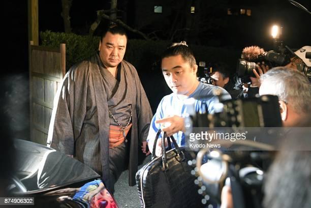 Grand champion Harumafuji gets in a vehicle without responding to reporters in Dazaifu in Fukuoka Prefecture southwestern Japan on Nov 16 2017 The...