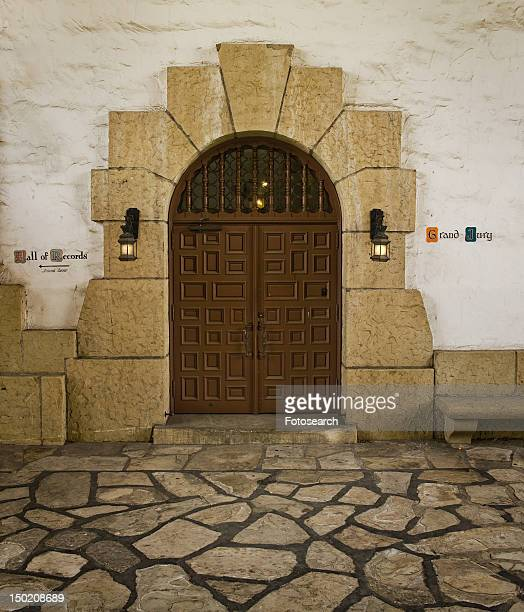 grand double doors with sandstone arch - santa barbara county courthouse stock pictures, royalty-free photos & images