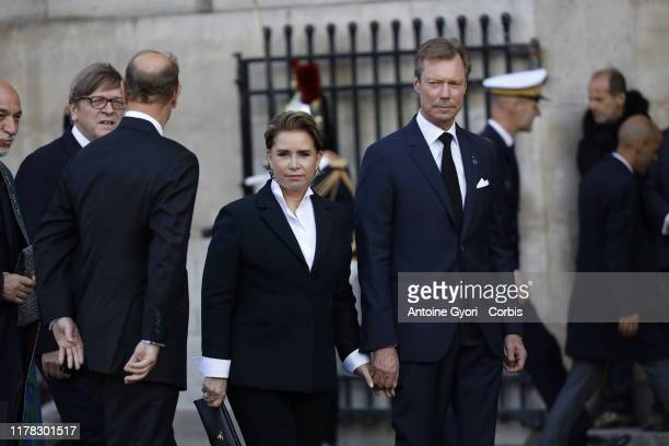 Grand Duc Henri of Luxembourg and Grand Duchess Maria Teresa of Luxembourg arrive to attend a church service for former French President Jacques...