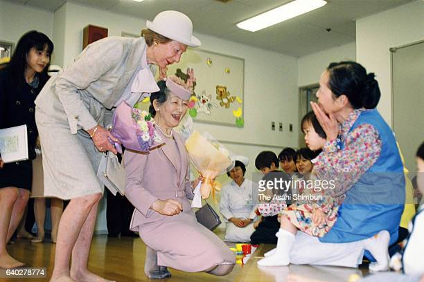 Grand Duchess Josephine Charlotte of Luxembourg and Empress Michiko visit the Home for Infants of the Japan Red Cross Medical Center on April 7 1999...