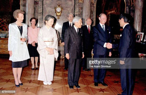 Grand Duchess Josephine Charlotte of Luxembourg Empress Michiko Emperor Akihito and Grand Duke Jean of Luxembourg welcome guests prior to the...