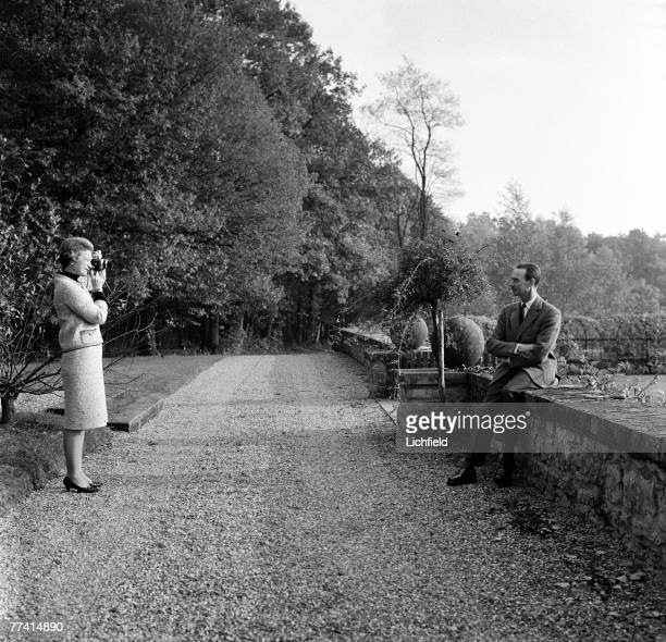 Grand Duchess Josephine-Charlotte photographing HRH Grand Duke Jean of Luxembourg at home in the grounds of the Grand Ducal Palace on 13th October...