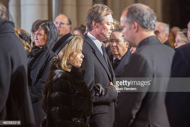 Grand Duchess Maria Teresa and Grand Duke Henri of Luxembourg attend the funeral of Queen Fabiola at Notre Dame Church on December 12 2014 in Laeken...