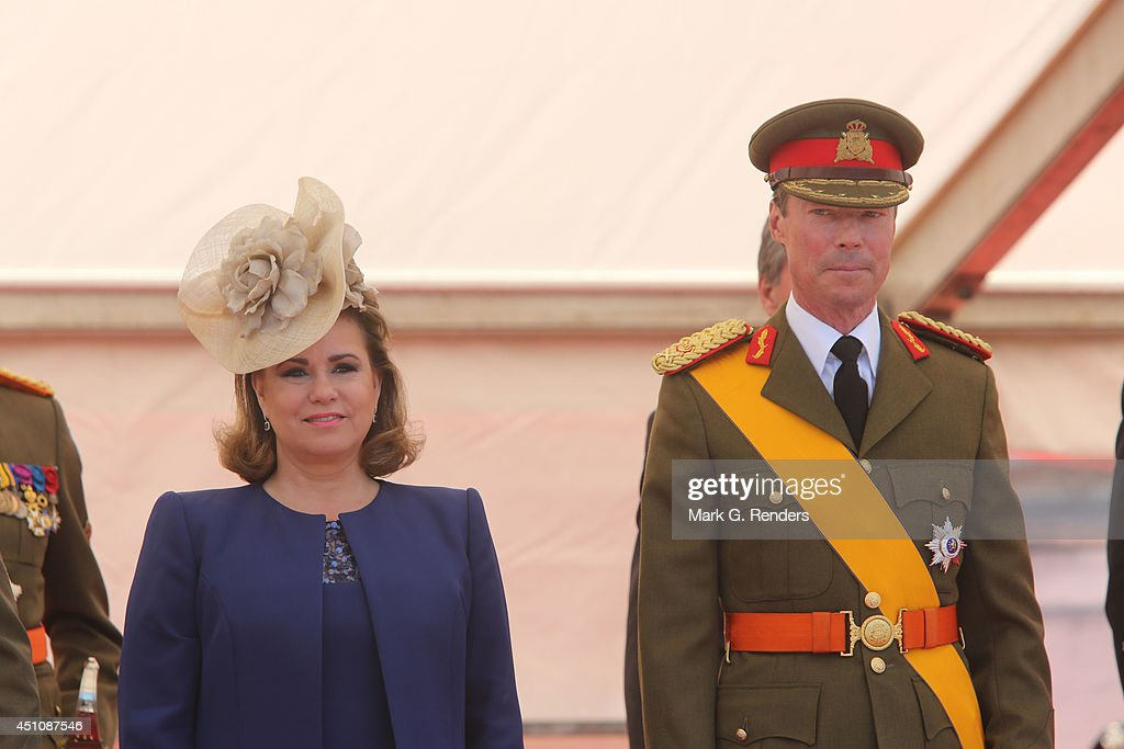 Grand Duchess Maria Teresa and Grand Duke Henri of Luxembourg celebrate National Day during the parade on June 23, 2014 in Luxembourg, Luxembourg.