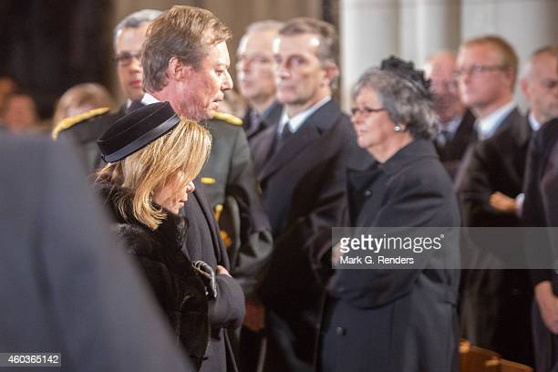Grand Duchess Maria Teresa and Grand Duke Henry of Luxembourg attend the funeral of Queen Fabiola of Belgium at Notre Dame Church on December 12,...